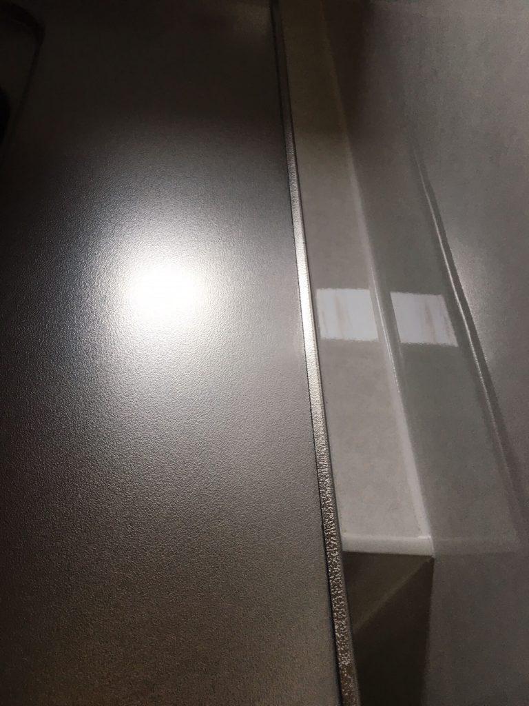 エンボス調ステンレス天板凹み修理